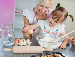 Young mother and child baking cookies