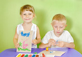 Children are molded from colored clay poster