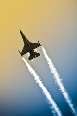 military jet aerobatics into an abstract gradient sky