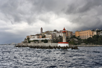 France, Corsica, Bastia, view of the port light and the town