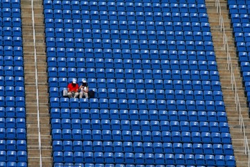 A couple alone in the stadium