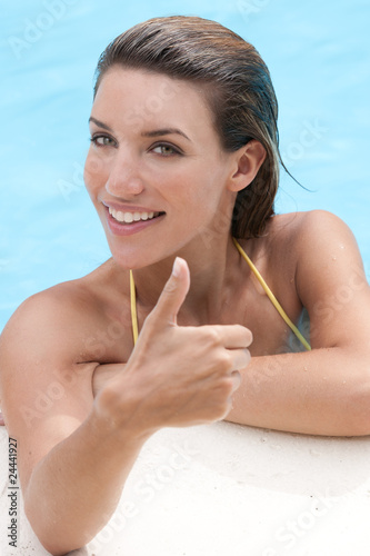 Woman in Pool Giving Thumbs-Up