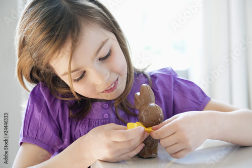 close-up of a girl playing with an easter bunny