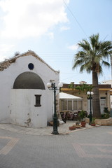 old cretan village view with palm and restaurant