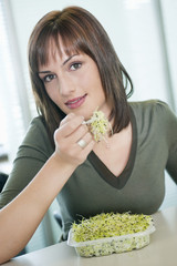 businesswoman eating bean sprouts