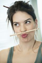 woman balancing a pencil on lip