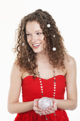 woman holding a crystal ball and smiling