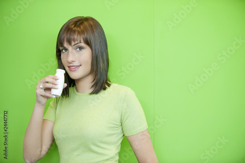 portrait of a woman drinking probiotic drink.
