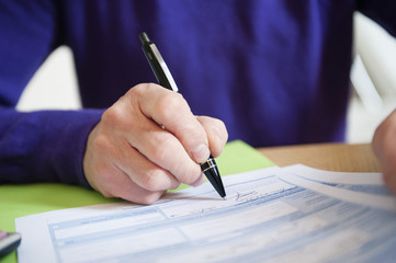 man filling his tax form