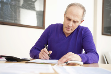man filling his tax form