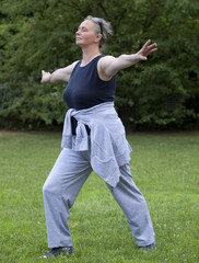 Healthy Senior Woman Stretching Muscles
