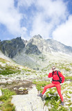 woman backpacker at Five Spis Tarns, High Tatras,Slovakia