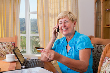 woman buying online and paying with credit card