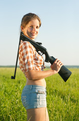 girl holding pneumatic pneumatic air rifle outdoor