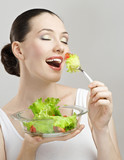 A beautiful slender girl eating healthy food poster