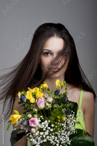 Beauty with a bunch of flowers
