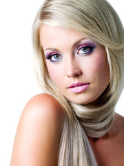 Blond woman with long straight hairs and bright pink make-up