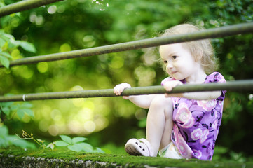 Adorable toddler girl on a green background