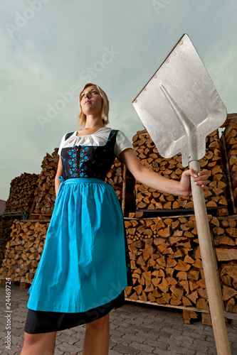 bavarian girl outdoor with a shovel