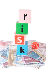 euro risk in toy play block letters