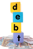 money debt in toy play block letters