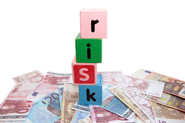 money risk in toy play block letters