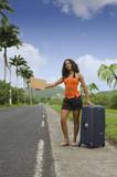 Fototapety Auto stopeuse avec une grosse valise
