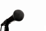 a black microphone on an isolated white background