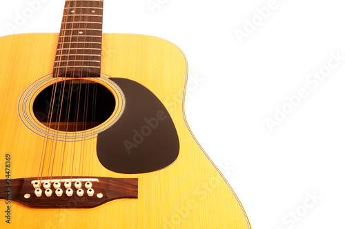 a 12 string acoustic guitar on an isolated white background