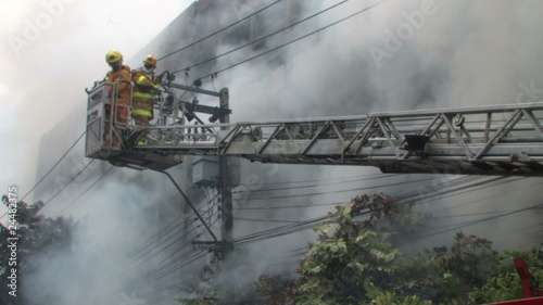 Firefighters battle blaze on Bangkok street, 2010