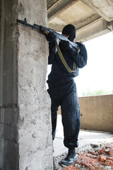 Soldier in black uniform with rifle