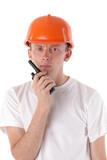 workman talking on portable UHF radio transceiver poster
