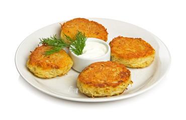 Four potato cakes on a white plate