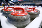 Group of curling rocks on ice