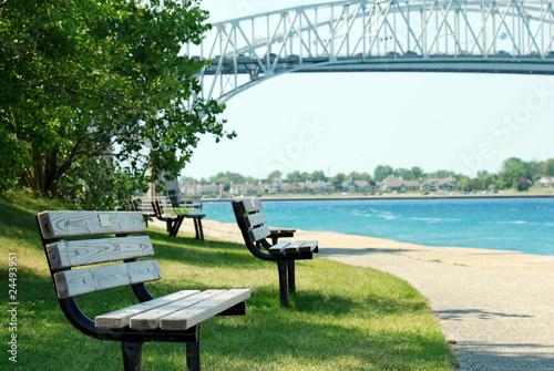 Fotobehang Grote meren park bench Sarnia ontario blue water bridge