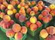 Organic Peaches for sale at outdoor farmers market