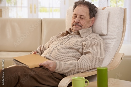 Senior man sleeping in armchair
