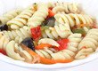 Close view of rotini salad in a small white dish