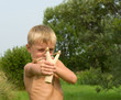 Child with a slingshot.