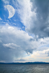 fantastic seascape with moon in the sky
