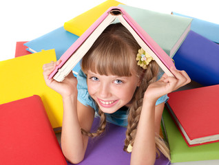 Child with pile of books on head.