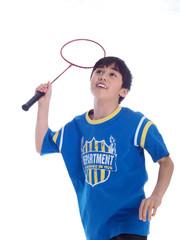 cute boy playing badminton