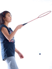 girl playing badminton failed to hit the shuttlecock