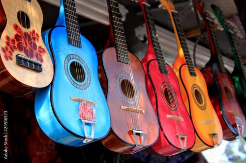 Leinwanddruck Bild bright colorful guitars for sale