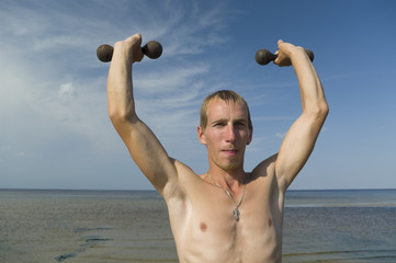 Boy with dumbbells.