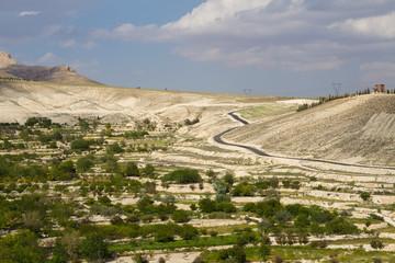 Windy road around a hillside
