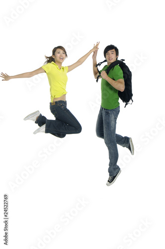 couple jumping - over a white background