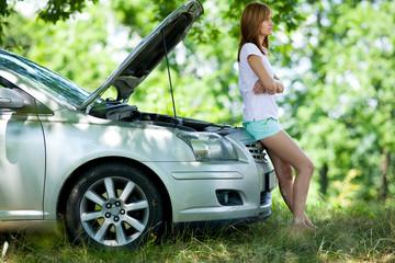 Woman with broken car