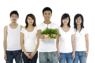 group of friends and young man holding small potted