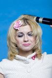 funny blond with hairdryer poster